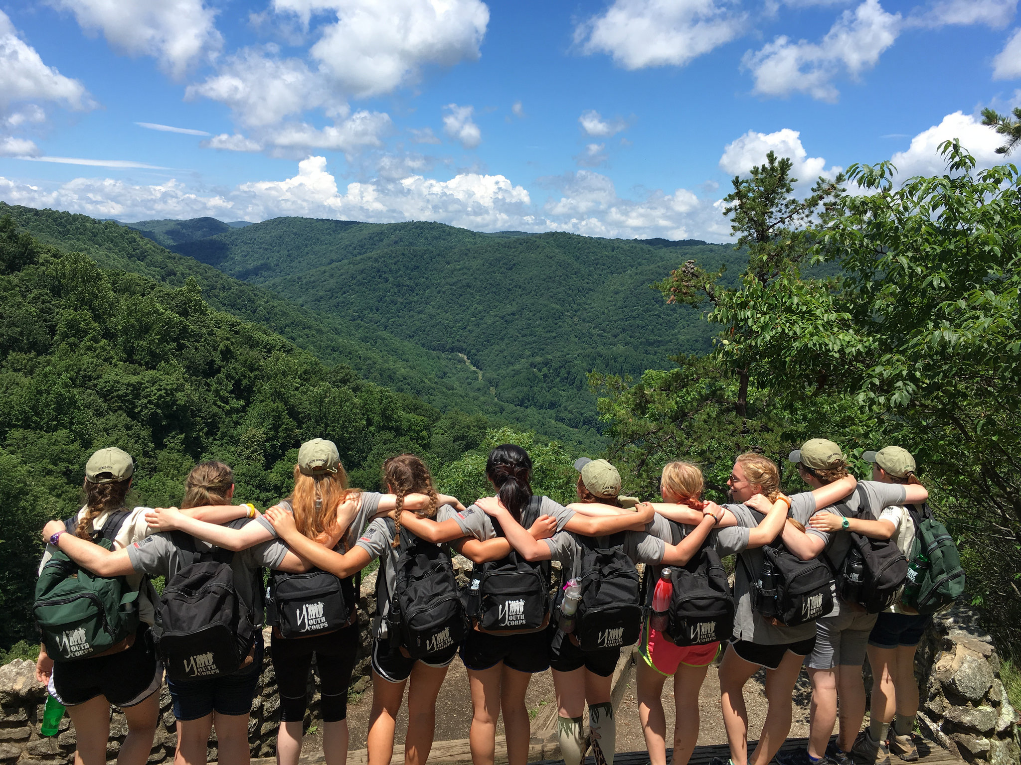 The crew from James River State Park celebrate their camaraderie while enjoying the view on a trip to Crabtree Falls
